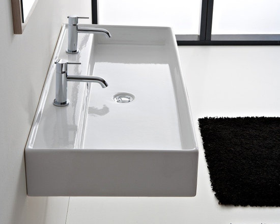 "Beautiful Ceramic 47 Inch Double Sink By Scarabeo - Beautiful wall mounted bathroom sink with overflow. Sink can be used as a double sinks (as shown) and as one big sink. Sink is made of high-quality white ceramic. Sink is made and designed in Italy, for premium quality. Sink dimensions: 47.2"" x 18.1"" x 5.7"""