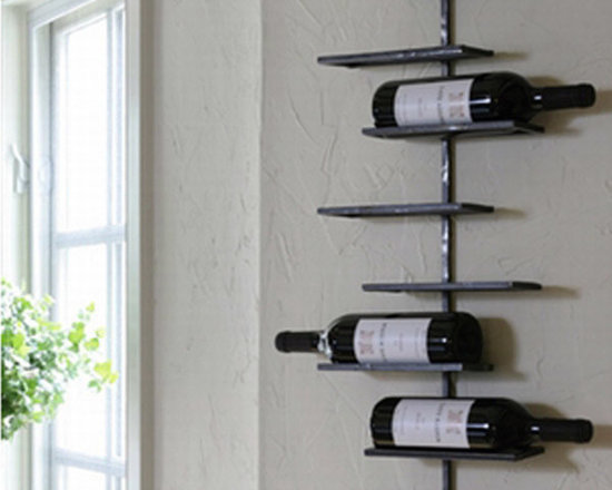 Tribeca 8-Bottle Wall Wine Rack - The Tribeca wall wine rack provides a wonderfully contemporary way to display your favorite wines as well as add style and functionality to your home. Made of metal with a natural gun-metal grey finish it displays 8 bottles of your favorite wine so that bottle labels are in full view. This upgraded line of handcrafted products has a continued long standing commitment to offer only attractive, fashion forward quality merchandise.
