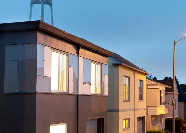 Grey stucco facade at twin peaks contemporary exterior for Stucco facade