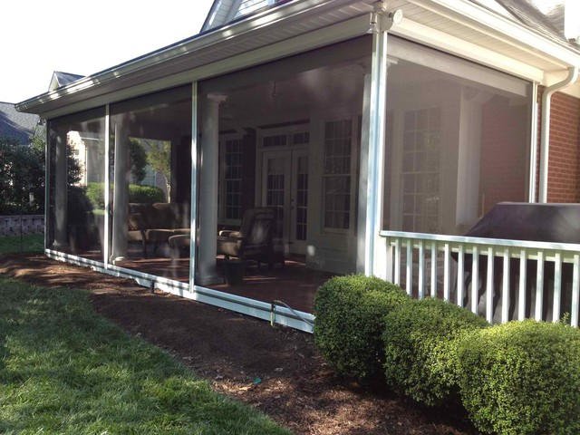 Phantom motorized screens in traditional porch Motorized porch screens