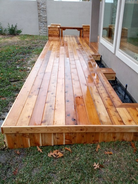 Natural cedar deck with flush mounted planter boxes. We build custom projects in