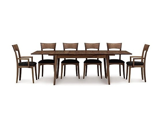 "Copeland Furniture - Catalina Four Leg Extension Table, 72 X 40 Inches | Copeland Furniture - Made in Vermont by Copeland Furniture.Combining the clean, unadorned lines with organic and geometric forms, the Catalina Four Leg Extension Table 72 X 40 Inches draws inspiration from America's Mid-Century Modern designers. Designed to accommodate large and small dinner parties, Catalina expands up to 96"" wide. Easy to operate, the integrated butterfly leaf stores directly in the table and requires only one person for operation. Product Features:  Natural variations in wood and hand-applied finishes make each piece unique Self equalizing, ball bearing extension glides Single 24"" self-storing butterfly leaf Single handed operation Expands up to 96"" wide Eco-friendly Hand-assembled Finished with a low sheen top coat"