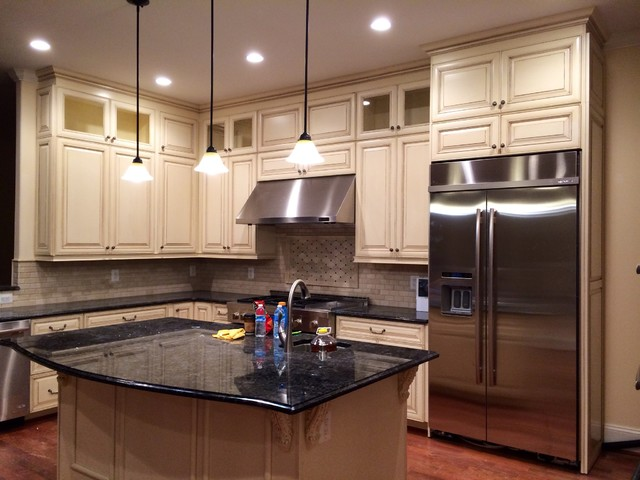 cream white cabinets with stainless steel appliances