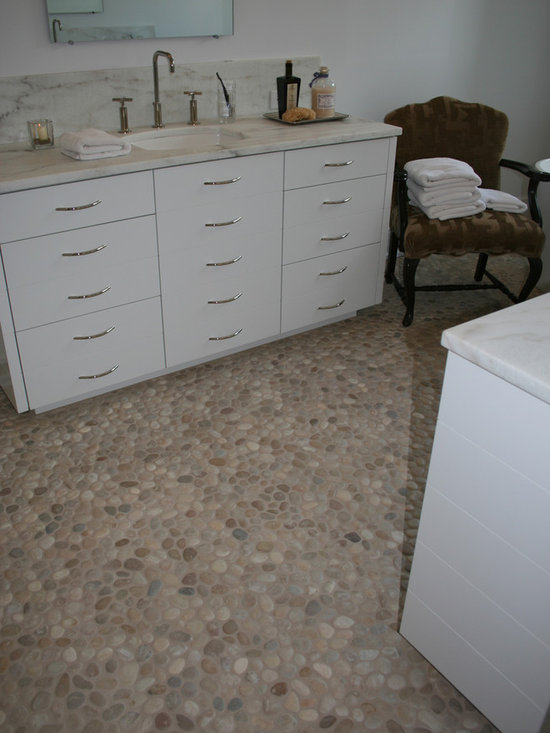 "Island Stone Pebble Bathroom Floor - Island Stone invented the ""pebble tile"" in 1998 and our Perfect Pebble Tile remains the premier pebble tile in the world. Pebbles are individually sorted to insure only using pebbles displaying  the highest quality, size, color and flatness.  These small, premium pebbles are placed in our proprietary interlocking shape to create a pebble tile of unmatched consistency and quality."