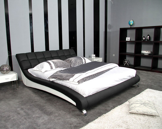 Catalina Bed Frame - Sleek sweeping lines and an eye catching two tone design combine with rich hand-tufted genuine leather to create the perfect addition to your modern bedroom decor.