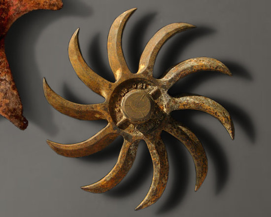 """Antique Industrial Gear Decor - Extra-amazing old metal wheel in a dynamic spiral-tine design. Thick, aged steel with a VERY worn crusty/rusty patina! Custom metal wall bracket projects sculpture 2"""" from wall to create interesting play of light and shadow. 10.5"""" diameter."""