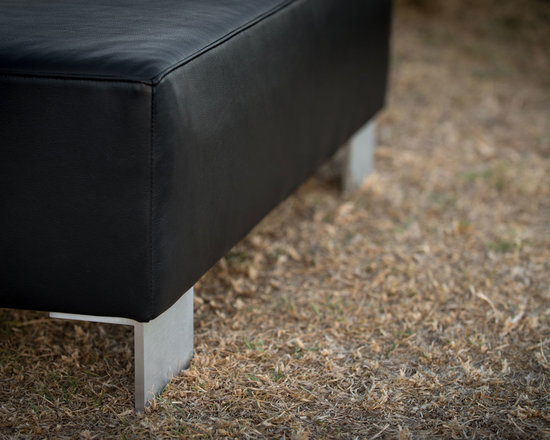 Gorgeous Creatures New Zealand - Modern black leather ottoman - This lovely black leather ottoman (110x55x35cm) was made to measure for our client. The modern aluminium legs give this a contemporary feel.