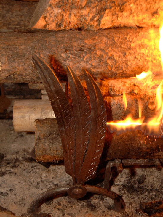 Fireplaces - Custom designed, hand forged, wrought iron fireplace and irons and grate.