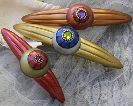 "Susan Goldstick, Inc. - Orbit Cabinet Pulls - Jewel tone orbit pulls measure  5 and 7""  and  are available in 4"" and 5"" hole spans.  Orbit pulls can be combined with matching knobs to decorate kitchens, baths and built in cabinetry."