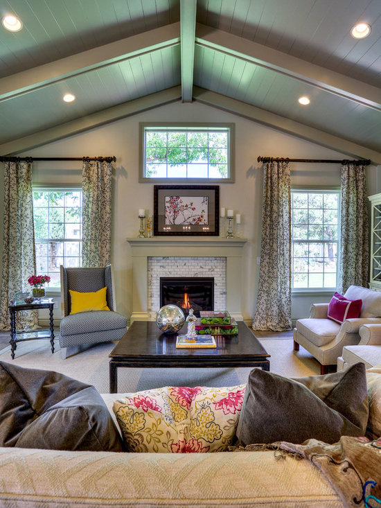 Parade of Homes - Cast stone fireplace mantel with tile fillers and hearth - Ivory Homes