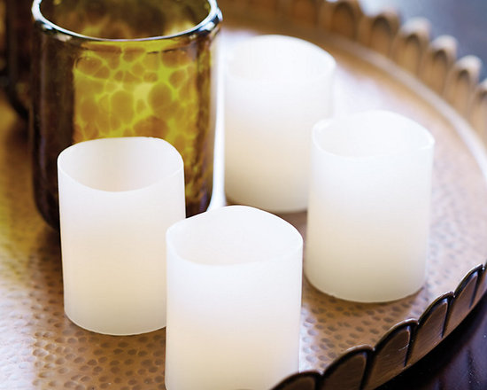 Ballard Designs - Flameless Wax Votives - Set of 4 - Lithium cell battery included. 100-hour battery life. Unscented. With our Flameless Wax Votive, you can enjoy the romance of flickering candlelight without the worry of an open flame or the hands-on hassle. This flameless LED candle is coated in ivory paraffin wax for a remarkably realistic look. Flameless Wax Votive features: . . .