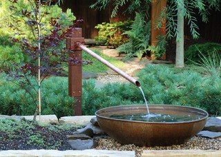 hot landscaping ideas include a variety of water features like this one