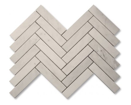 Calcutta honed large herringbone stone mosaic tile
