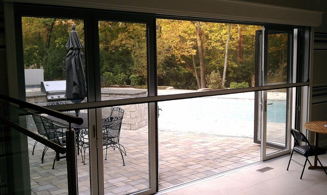 Mirage motorized screen with nanawall system windows and for Retractable windows and doors