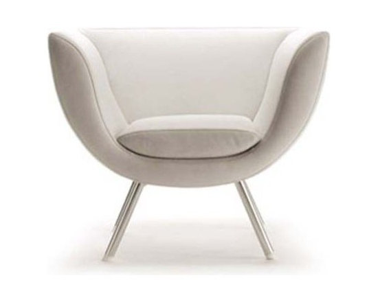 Estel - Estel | Spline Armchair - Spline armchairs feature a shaped steel frame that envelops sitters in luxury and comfort. Covered with molded polyurethane foam and upholstered in leather or fabric, Spline Armchair's seat is padded for aesthetic appeal and optimal support. This version features chrome plated feet. Also available in a swivel pedestal base.