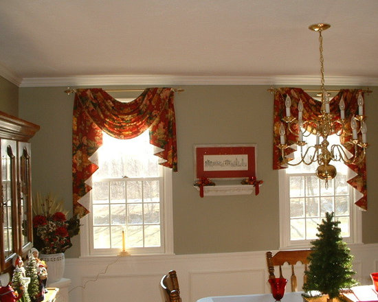 Window Treatments - These gorgeous asymmetrical swags add a touch of elegance to this dinning room