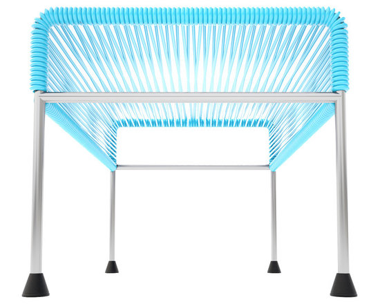 Adam Ottoman, Chrome Frame With Blue Weave - Sleek woven vinyl makes this coffee table stand out from the crowd. It's a great option for indoor and outdoor entertaining since the vinyl is UV protected and the metal base is galvanized. The only challenge would be deciding on your favorite color top to pair with the sleek chrome base.