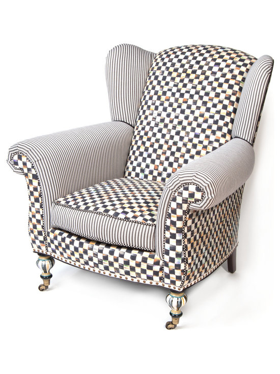 Courtly Check Underpinnings Classic Wing Chair | MacKenzie-Childs - A classic, cozy, settle-in-with-a-good-book wing chair, upholstered in Courtly Check® and ticking stripe. Made in the U.S. with an eco-friendly frame of sustainably harvested hardwood and eight-way hand-tied coil construction for outstanding comfort. Antique brass nailhead trim and castered legs. All green-manufactured in our commitment to domestic manufacturing and responsible practices.