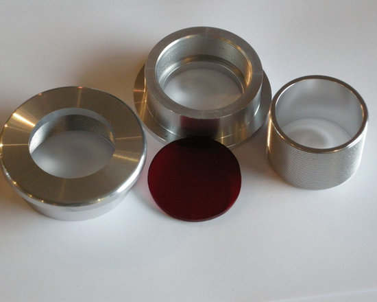 Doorlenz Assembly & Installation - Unassembled Doorlenz (round door window) consisting of two flanges, a threaded insert and red lenz.