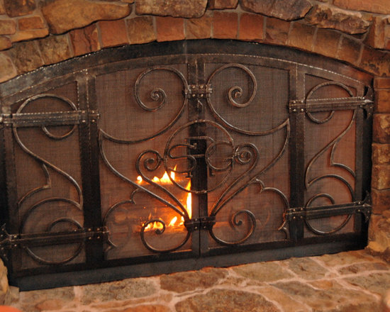 Fireplaces - Custom designed, hand forged, wrought iron fireplace screen and stone hearth.