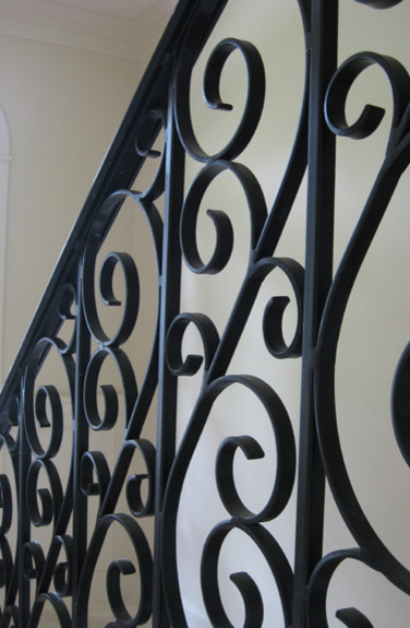 Wrought Iron Stair Railing in a Traditional English Home traditional