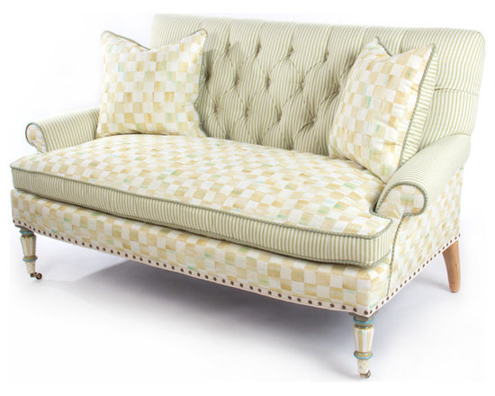 "Parchment Check Underpinnings Loveseat | MacKenzie-Childs - In what we like to call our ""new neutral"" palette, we've taken our successful new pattern—Parchment Check™—and exquisitely printed it in Italy on highest-quality cotton viscose. Parchment Check™ blends tones of ivory, wheat, ochres, and aquas, and has been widely accepted as our new hallmark. We playfully mix it with ticking stripes and hand-painted elements for a furniture line that is soft, elegant, and adaptable to so many settings. Think Downton Abbey meets Big Sur. The Parchment Check™ Underpinnings Collection is lovely and demure, yet energetic and unique. Originally called the ""apartment sofa,"" this comfortable little piece is perfect for a smaller room or as a complement to a larger couch. Made in the U.S., all Underpinnings pieces feature an eco-friendly frame of sustainably harvested hardwood and eight-way hand tied coil construction for outstanding comfort. All green-manufactured in our commitment to domestic manufacturing and responsible practices."