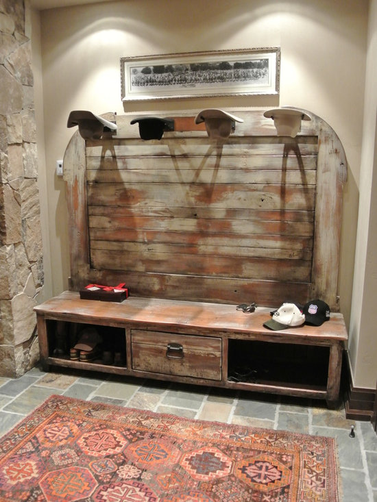 Reproduction Depot Bench - This is a reproduction of an early 1900s train depot bench. We take particular pride in the back story of this piece and creating evidence throughout of a century of use. Created to fit a specific alcove, it is now resting comfortably in its home in Nevada.