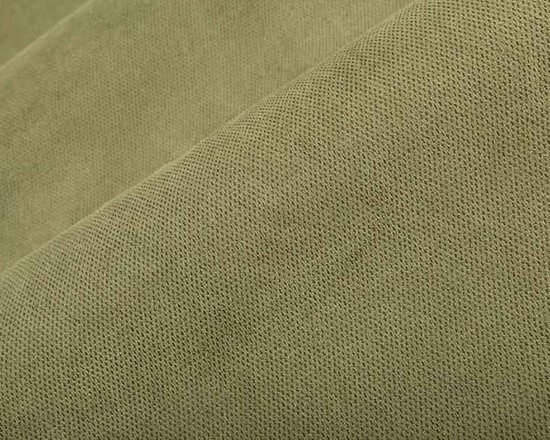 Giggles Upholstery Fabric in Sage - Giggles Ultra-Suede Upholstery Fabric in Sage is an ultra soft, ultra-suede fabric that will bring a soft and contemporary feel to interior designs. It is perfect for upholstery projects and accent pillows. Made from 100% polyester, this highly durable upholstery fabric passes 54,000 double rubs on the Wyzenbeek Abrasion Test. Cleaning Code: S; UFAC: Class I; passes CA117 Test. Width 54″.