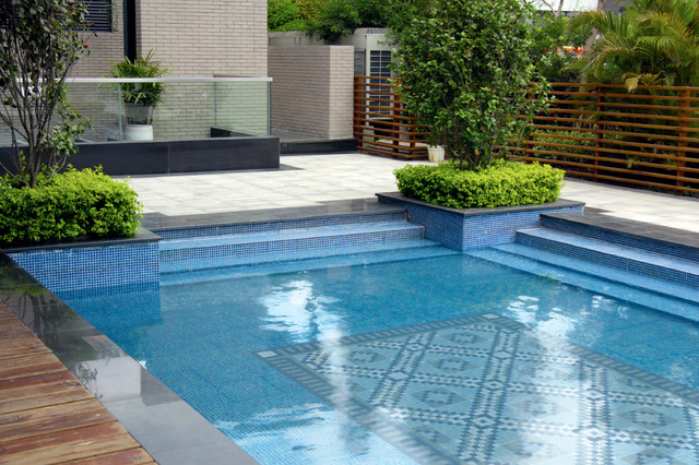 Tips in choosing swimming pool tile interior decorating for Gartenpool metall