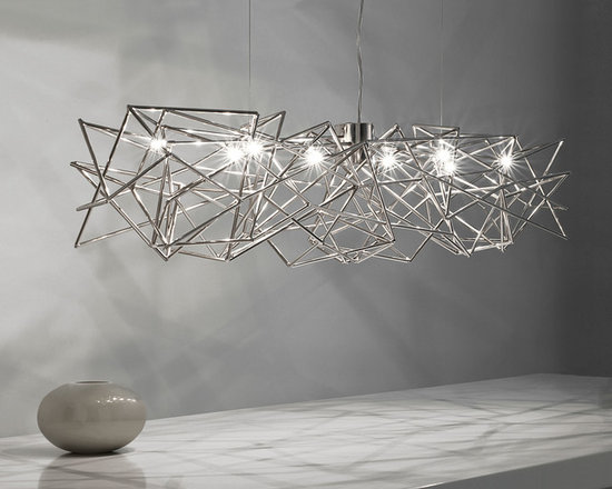 """Etoile Linear Suspension by Terzani USA - Etoile linear suspension in nickel finish is a celestial fixture made of interwoven shafts that glitter from all directions. Designed by Christian Lava. Its intricate network of intersecting nickel lines recalls constellations in a clear sky. Strategically placed bulbs cast a starry light, twinkling as viewers move around the pendant. Requires eight 20 watt 12 volt, JC, G4 bi-pin xenon lamps, not included. General light distribution. ETL listed. Overall height is 39.4 inches, adjustable at installation. 51.2""""width x 7.9"""" height."""