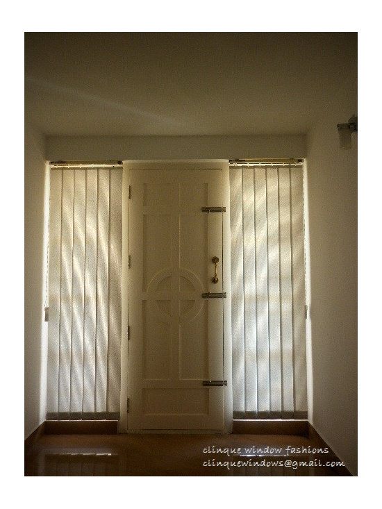 Karimpana, A house covered by vertical blinds. - Clinque Window Fashions