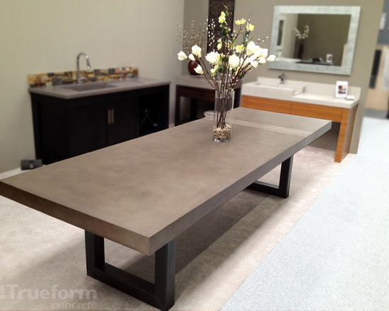 "Dining Table - Trueform Concrete - This is a Concrete Dining Table by Trueform Concrete that was shown in the Architectural Digest Show in NYC.  The table is 10' long x  40"" wide x 3.5"" thick.  The table is a custom version of the Trueform Concrete Zen Table. The photo shows an integral design detail that runs through the concrete table."
