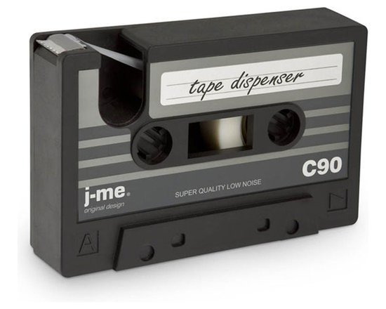 j-me Original Design - It's official... cassette tapes are back! This easy to use tape dispenser is in the shape of a cassette tape. We'd like to see them try to pull this off with a CD! Mix things up at your desk and pay homage to the beloved cassette tape of the 70s and 80s with this heavy duty, lighthearted rubber desk accessory.