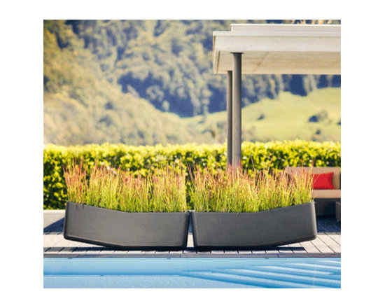 Balance Planter - Large planting area provide room for creative ideas - These planters are sleek and modern with a playful element. I like how they balance and show daylight between them.