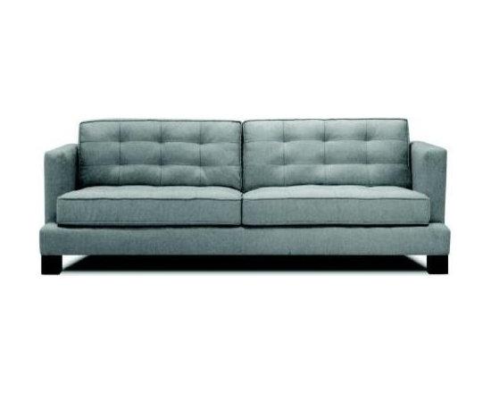 Flynn Sofa - The dramatic platform style, tufted cushions, and block feet make the Flynn sofa a beautifully unique piece.