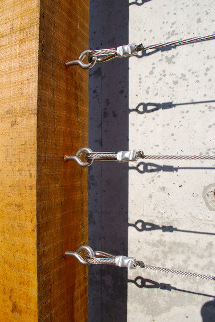 Fasteners on a custom wood and wire trellis contemporary-exterior