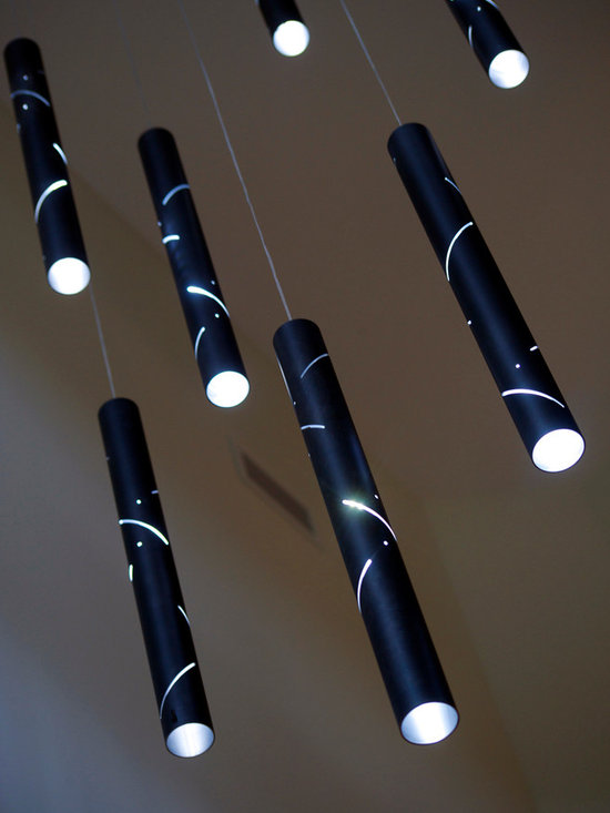 Black Rain. - Black rain features elongated light drops, created in a complex process. From the outside they are painted in a sensual satin black finish whilst their exposed linished interior enhances and refract illumination. A sequence of slots wraps around the drops and throws magnificent patterns on its surroundings.