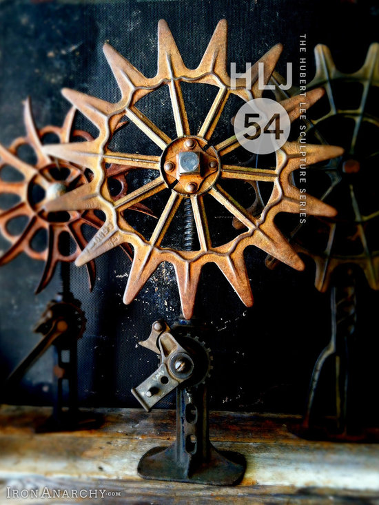 """Antique Industrial Gear Decor - Ornate 1800's cast iron wheel mounted on an antique buggy jack pedestal. 25"""" tall."""