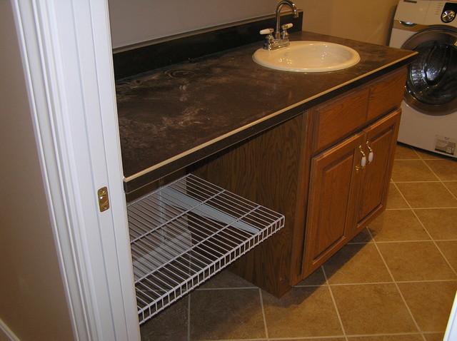 Beige Bathroom Tile traditional-laundry-room