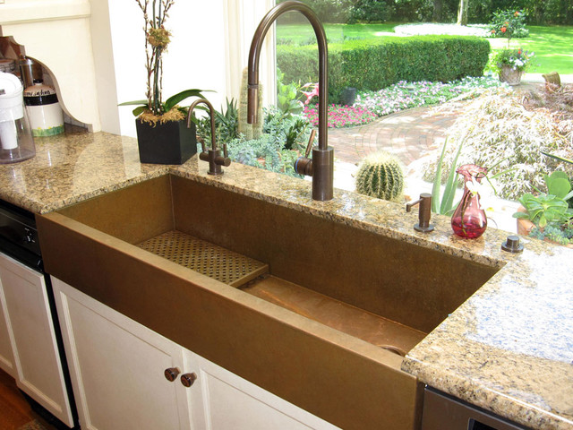 Large copper apron front sink by Rachiele eclectic kitchen sinks