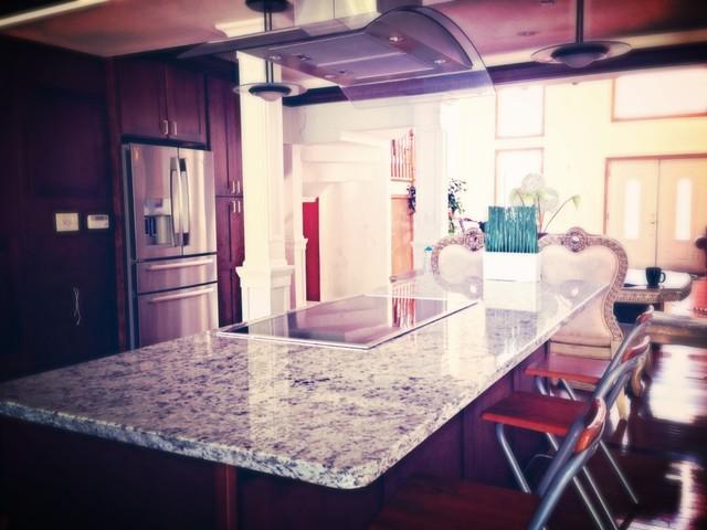 Dallas White Granite Countertops On Cherry Cabinets