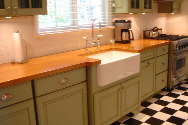 Green cabinets classic black and white tiled floor new for Green kitchen cabinets