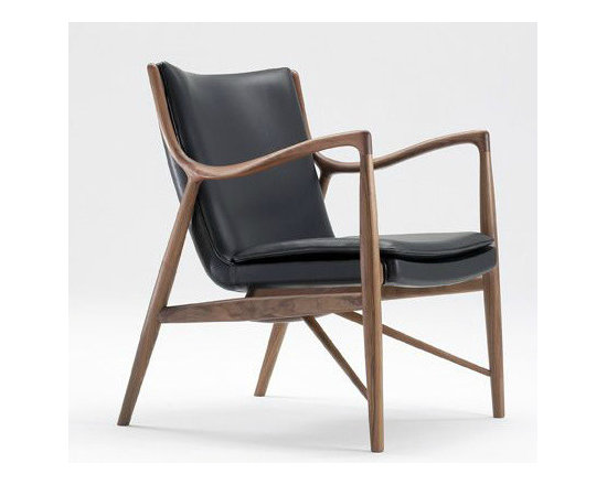 Model 45 Chair - I can't seem to grasp how wood can be made to look so fluid and molded. This armchair is living proof that Scandinavian design has the market cornered on mid century wood furniture.