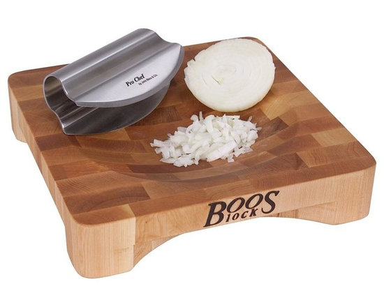 John Boos - 2 in. Thick Non-Reversible Cutting Board w Ro - Includes stainless steel double bladed rocker knife. Hard maple end grain construction. Concave bowl rotates product being chopped to the center. Cut-out base permits dish to be partial slid underneath for ease emptying contents. 2 in. Thick non-reversible cutting board. 10 in. L x 10 in. W x 2 in. H (6 lbs.)