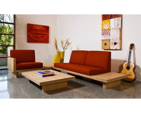 Bamboo Float Sectional - This modern sofa pairs bamboo for the base, with upholstered seating mounted to the top. A creative and unique Green furniture idea, implemented with style and grace. This sectional has an Asian Zen quality about it, feeling very light and balanced with its textures and form. End tables come with the sofa, completing the thoughtful design. Designed by Robert Swatt.