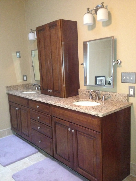 """Bathroom remodel - Amanda - 92"""" vanity was removed and replaced with a double sink unit and storage hutch.  The granite countertop was also installed on the tub.  New lighting and mirrors were installed."""