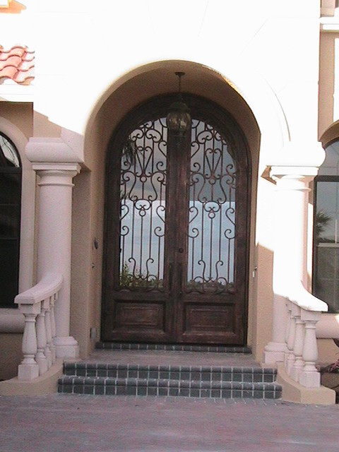 Forge Iron Designs mediterranean front doors
