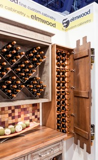 What better to store behind a cool wine bottle display door, then more wine bottles! With the ...
