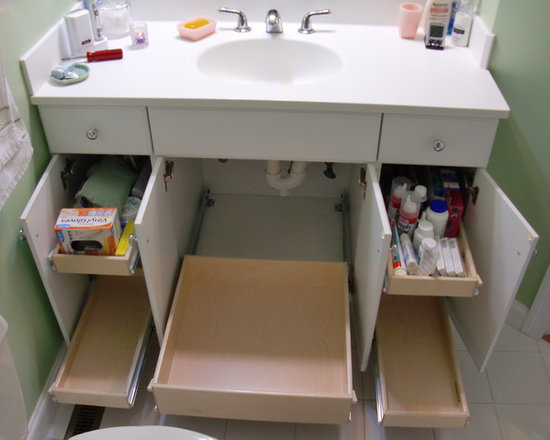 Bathroom Storage Solutions - Pull out shelves from ShelfGenie of Massachusetts for your bathroom vanity.  Our pull out shelves are custom made to fit your existing cabinets.