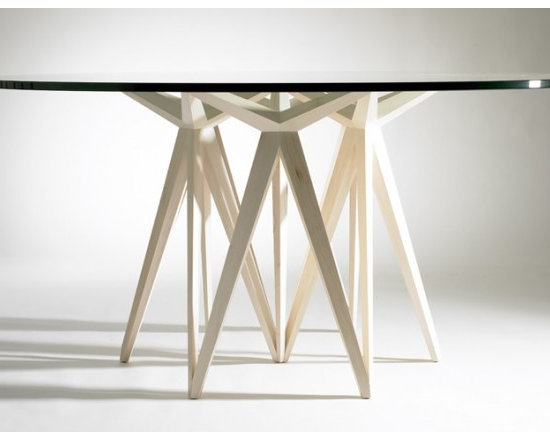 Eco Friendly Furnture and Lighting - Prism Round Dining Table.Taking a simple sketch of the human form as my inspiration, I developed Prism, a sophisticated geometric structure. Repetition illustrates what is possible structurally, as the resulting piece has greater strength than the combined strength of individual components. The proportion, shape, form and open spaces of Prism all combine to create a piece of aesthetic intrigue and significant structural integrity.